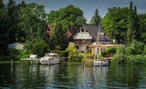 mansion on water with boat