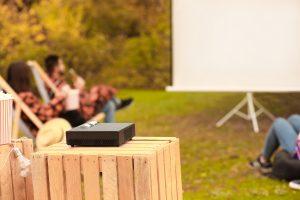 Multimedia DVD projector in outdoor cinema